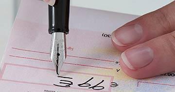 cheque stylo signature